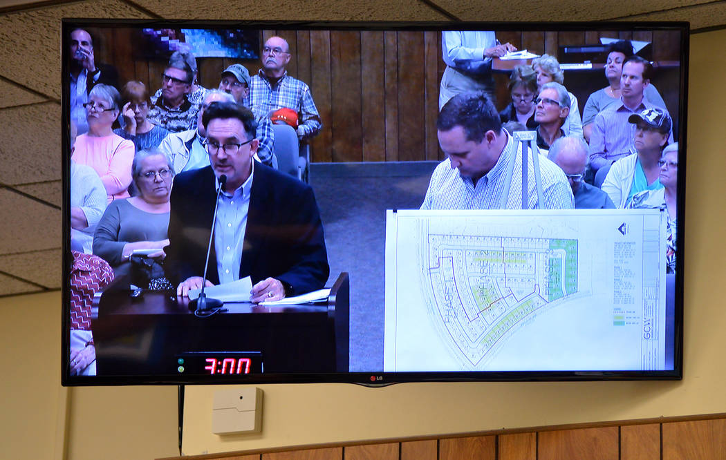 Celia Shortt Goodyear/Boulder City Review Wayne Laska, left, and Michael Gray of StoryBook Homes appeal the denial of their variance requests to the city council on Tuesday.