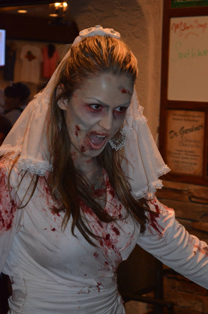 Courtesy A zombie bride prepares to walk through the streets of historic Boulder City during a recent Zombie Walk at the Boulder Dam Brewing Co. This year's charity fundraiser will be held at 7 p. ...
