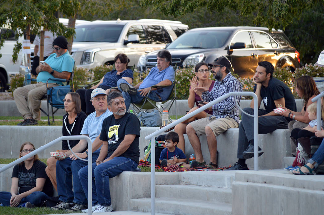 Celia Shortt Goodyear/Boulder City Review Residents enjoy music at the Boulder City Library amphitheater on Friday at a benefit concert for the victims of the mass shooting in Las Vegas on Oct. 1.