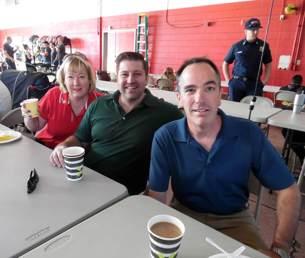 Hali Bernstein Saylor/Boulder City Review Among those enjoying the pancakes and camaraderie Saturday during the Boulder City Fire Department's annual pancake breakfast and open house were, from le ...
