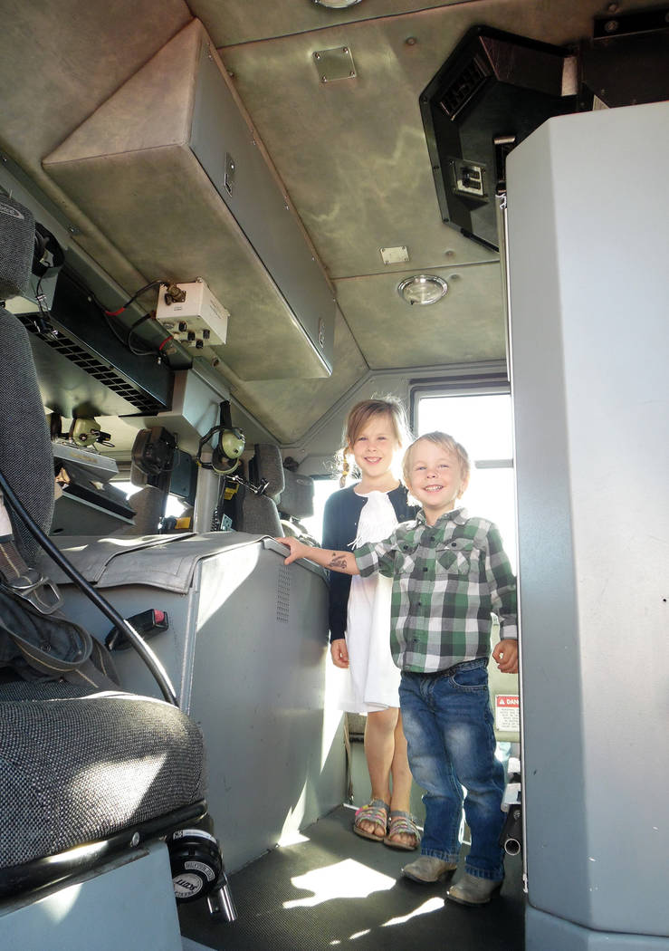 Hali Bernstein Saylor/Boulder City Review Lucy, 6, and Henry Keller, 3, of Boulder City were happy to explore one of the fire engines on display as Boulder City Fire Department hosted its annual p ...