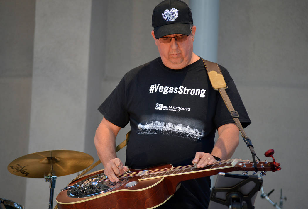 Celia Shortt Goodyear/Boulder City Review Richard Wells of The Unwieldies plays the Dobro at Friday's benefit concert to aid victims of the Oct. 1 mass shooting and their families. The concert was ...