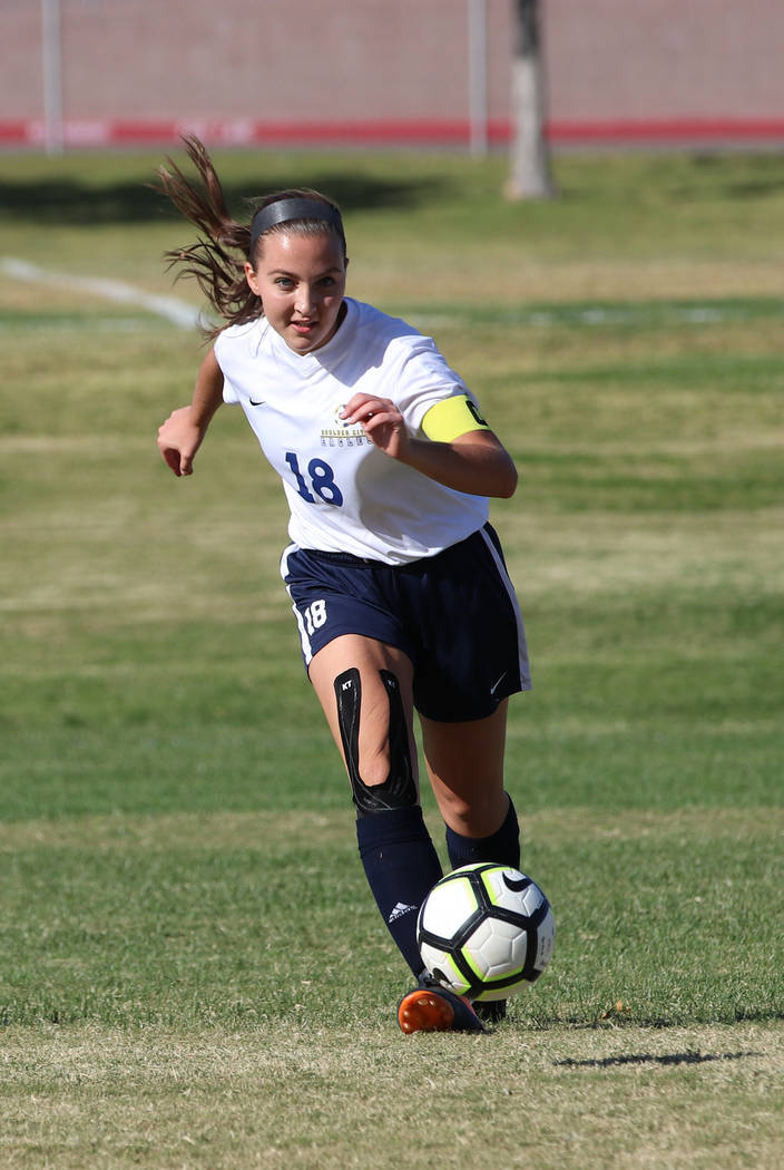 Tristin Phelps/Boulder City Review Boulder City High School senior Sydney Manns puts up a fight against the Virgin Valley Bulldogs on Oct. 12 as she races to take control over the ball. The Lad ...