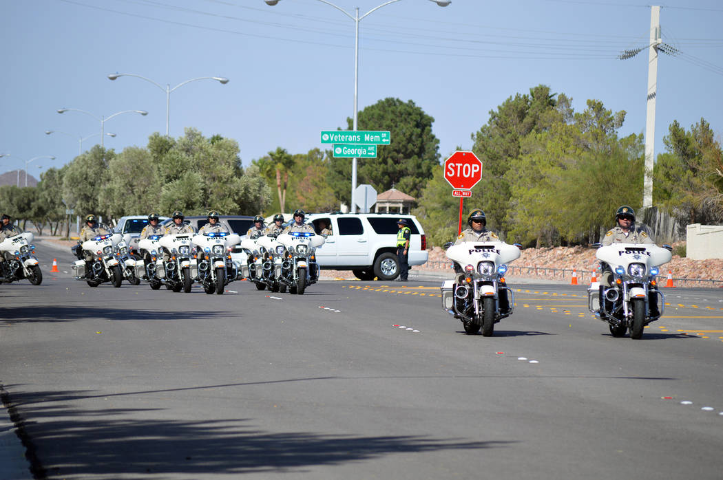 Celia Shortt Goodyear/Boulder City Review Metropolitan Police Officers from Las Vegas headed the funeral procession to Southern Nevada Veterans Memorial Cemetery for fellow officer Charleston Hart ...