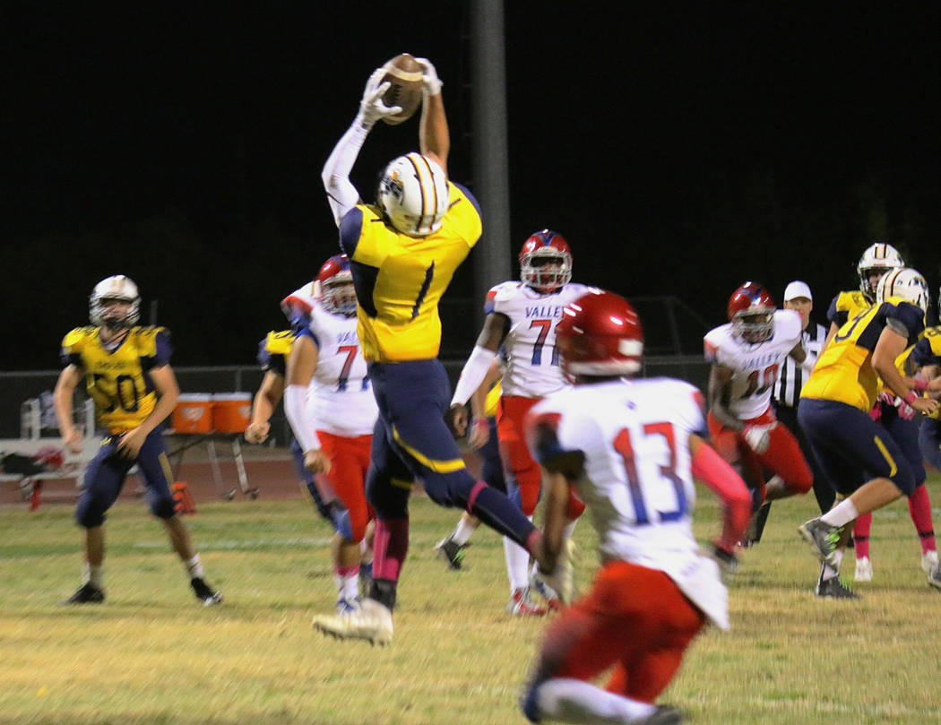 Laura Hubel/Boulder City Review Soaring through the air, Boulder City High School senior wide receiver Briggs Huxford converts a third-quarter first down during the Eagles' 33-32 loss to Valley on ...