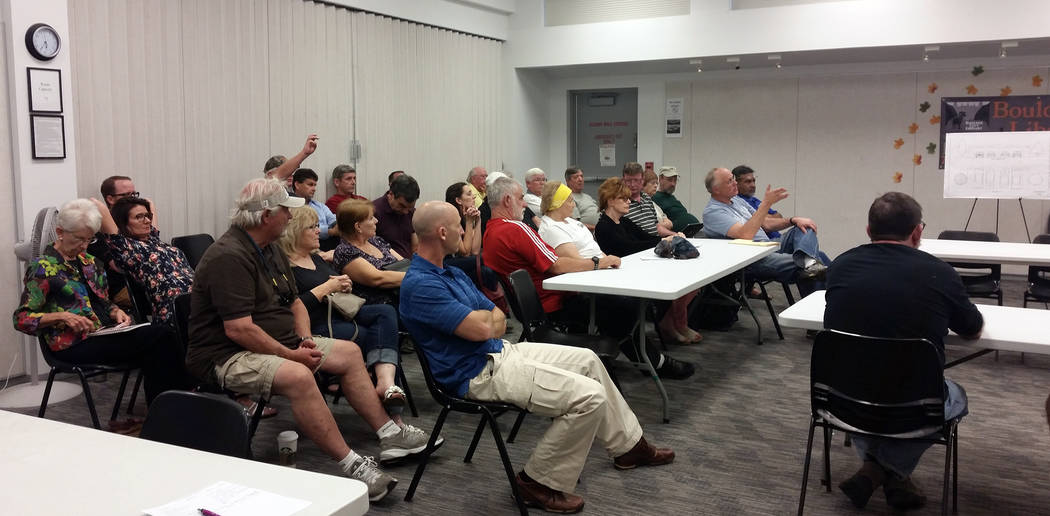 Celia Shortt Goodyear/Boulder City Review Residents ask questions about a proposed 129-home subdivision during a neighborhood meeting Oct. 26 at the Boulder City Library and hosted by StoryBook Homes.