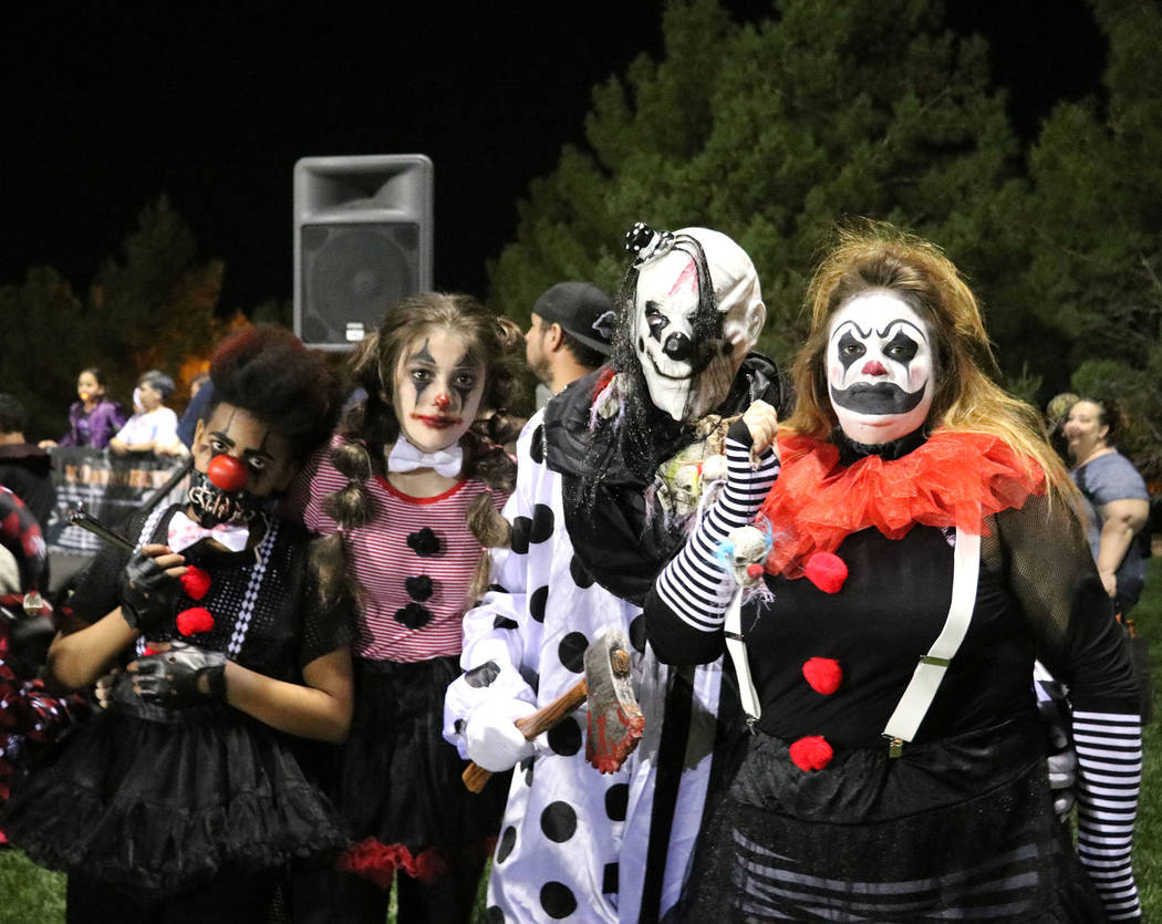 Tristin Phelps/Boulder City Review A local family of four dressed up in came as scary clowns hoping to win the prize for the group costume contest during Saturday's Trunk or Treat celebration at V ...
