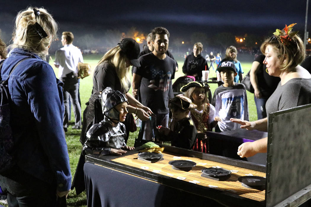 Tristin Phelps/Boulder City Review The knight in shining armor tosses bean bags to a victory prize during Saturday's Trunk or Treat at Veterans' Memorial Park.