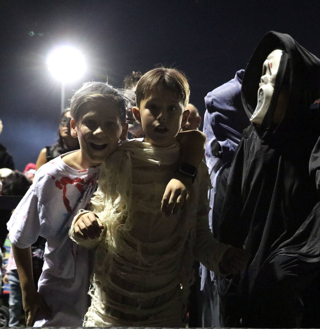 Tristin Phelps/Boulder City Review Two boys eagerly wait to show off their scary costumes in the scariest costume competition during the Trunk or Treat festitivies at Veterans' Memorial Park on Sa ...