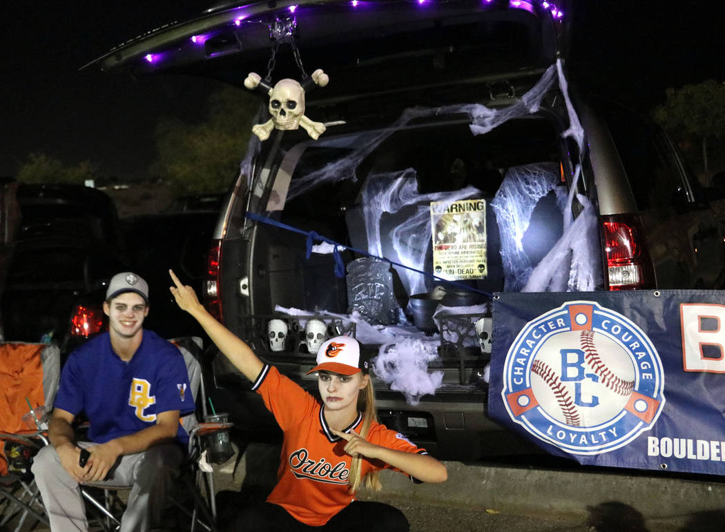 Tristin Phelps/Boulder City Review Zach Trone, left, and Taylor Cunningham came to Trunk or Treat on Saturday dressed as zombie baseball players. 