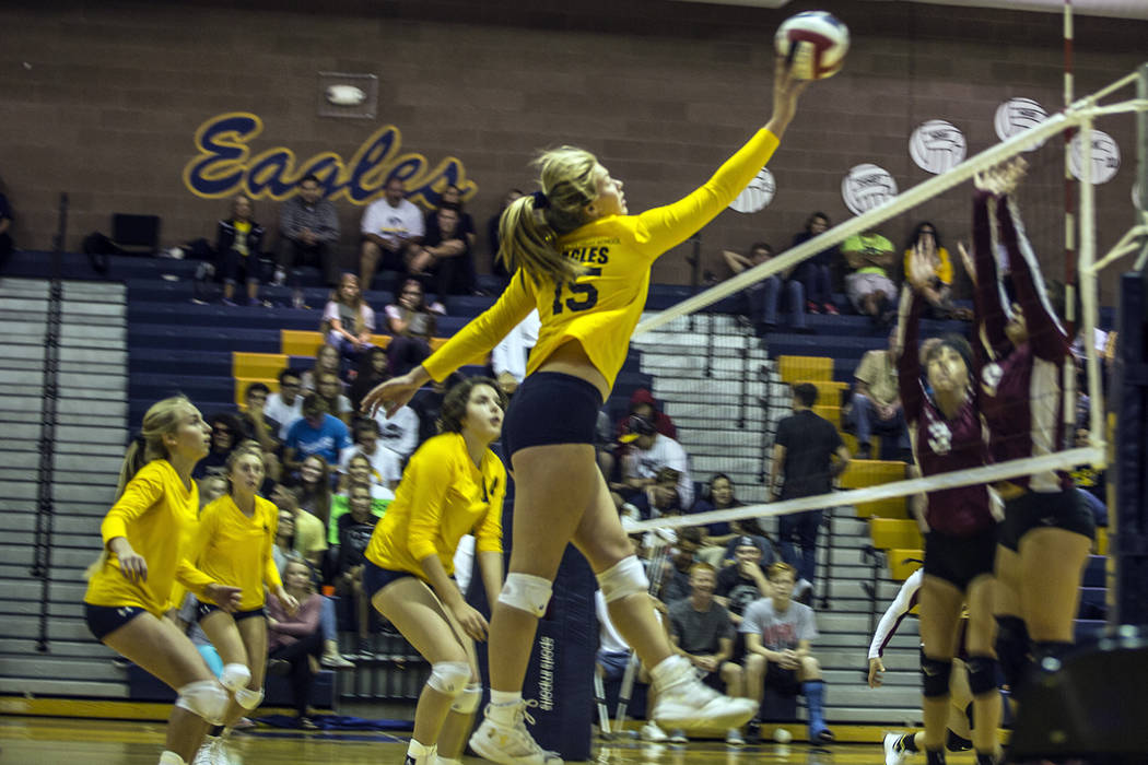 Oksana Saulenko/Boulder City Review Boulder City High School senior Maggie Roe, at the net, had 19 kills and eight assists during the Lady Eagles' Oct. 25 3-0 victory against Del Sol.