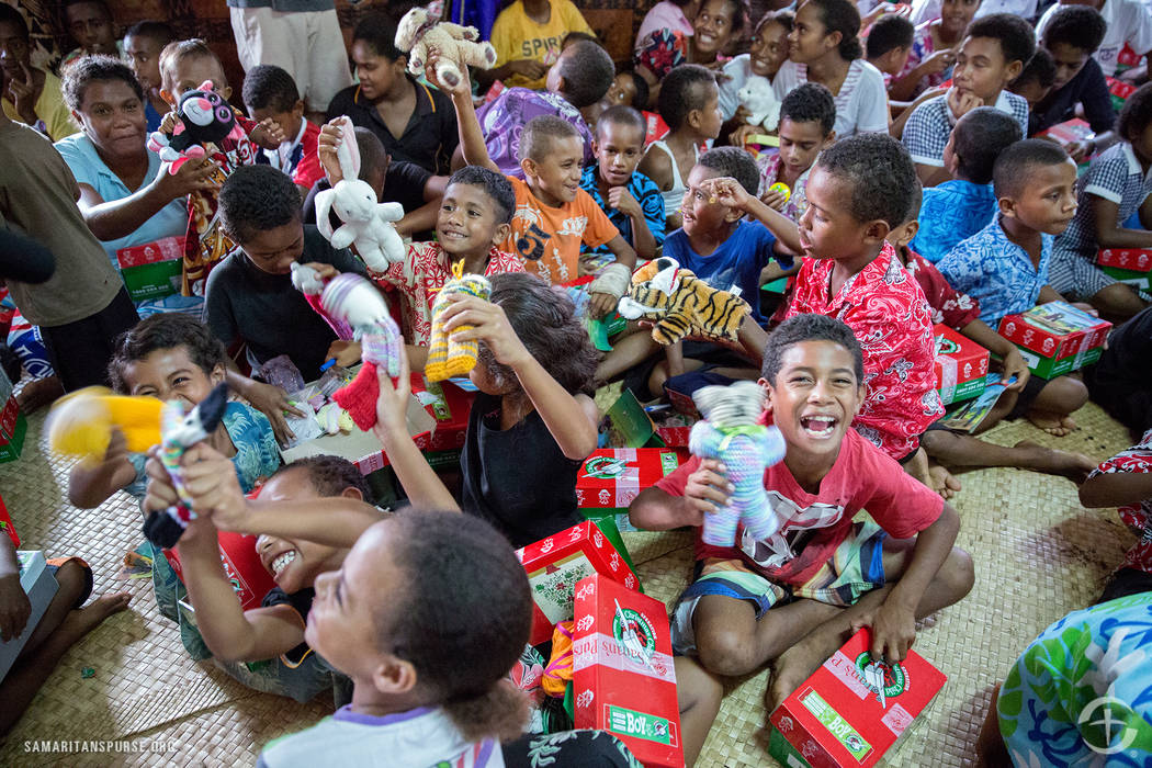 Samaritan's Purse/Operation Christmas Child Children in Fiji open their shoe boxes provided by Operation Christmas Child.
