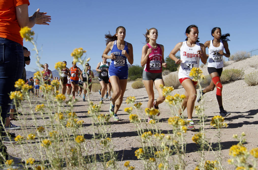 Chitose Suzuki/Las Vegas Review-Journal  Runners compete in a girls cross country race in Boulder City, Friday, Oct. 27, 2017. The Boulder City High School girls cross country recently took part i ...