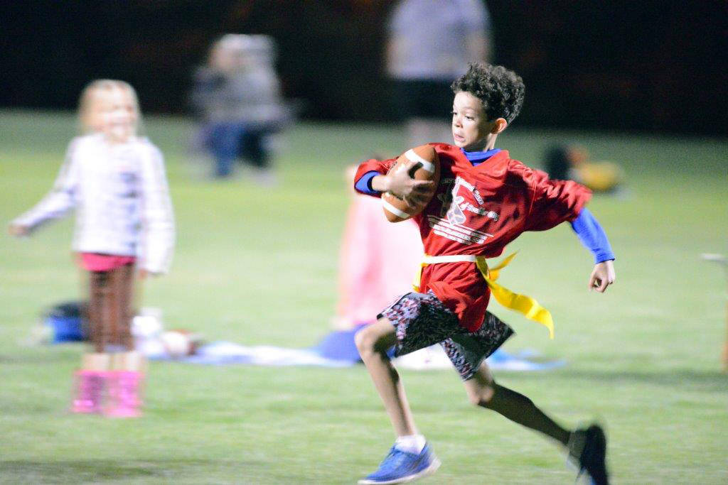 Boulder City Parks and Recreation Jayden Thackeray runs with the ball during a city recreation flag football game.