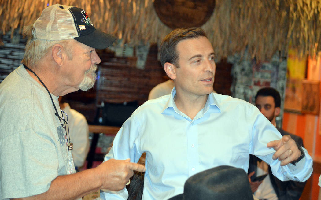 Celia Shortt Goodyear/Boulder City Review Nevada Attorney General Adam Laxalt, right, answers a question from Jerry Newman at the World Famous Coffee Cup in Boulder City on Tuesday, Nov. 7, about  ...