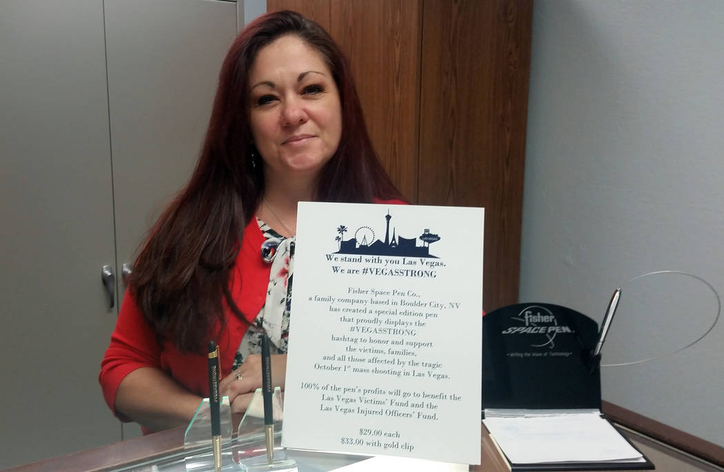 Celia Shortt Goodyear/Boulder City Review Christi Olsen, Fisher Space Pen's social media manager, showcases the VegasStrong pen she helped inspire at the company. All of its proceeds go to help th ...