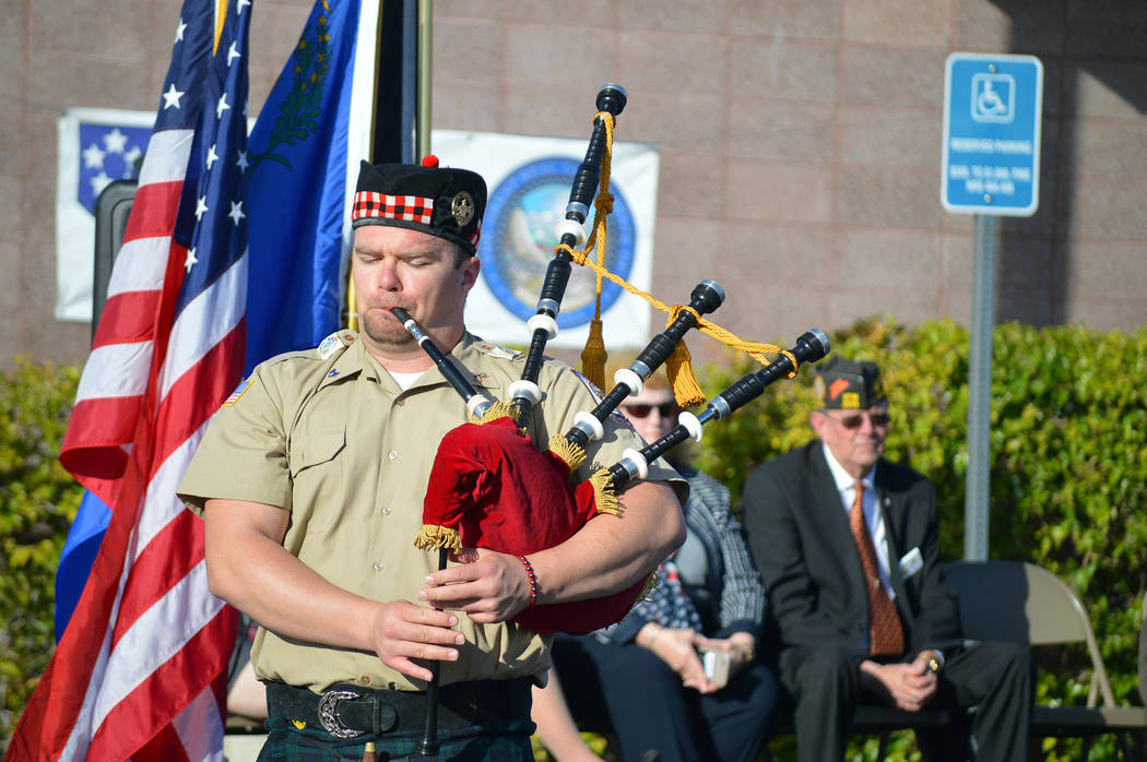 Celia Shortt Goodyear/Boulder City Review Auxiliary piper Brennan Tica of Scottish-American Military Society Post 711 retires the colors at the Veterans Day ceremony Saturday at the Nevada State V ...