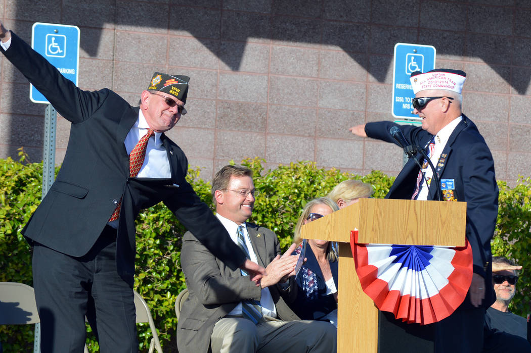 Celia Shortt Goodyear/Boulder City Review Bob Garlow, past commander of Veterans of Foreign Wars, Post 36, right, and John Stroud, past VFW national commander-in-chief, fly around the stage during ...