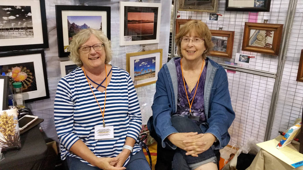 Celia Shortt Goodyear/Boulder City Review Artists Roni Ronemus, left, and Vicki Rosenberg and have a good time at 13th annual Winter ArtFest on Saturday at the Parks and Recreation building in Bou ...