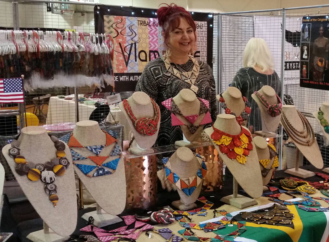Celia Shortt Goodyear/Boulder City Review Artist Flame showcases her tribal-inspired jewelry designs at the 13th annual Winter ArtFest on Saturday. All her jewelry is made from authentic South Afr ...