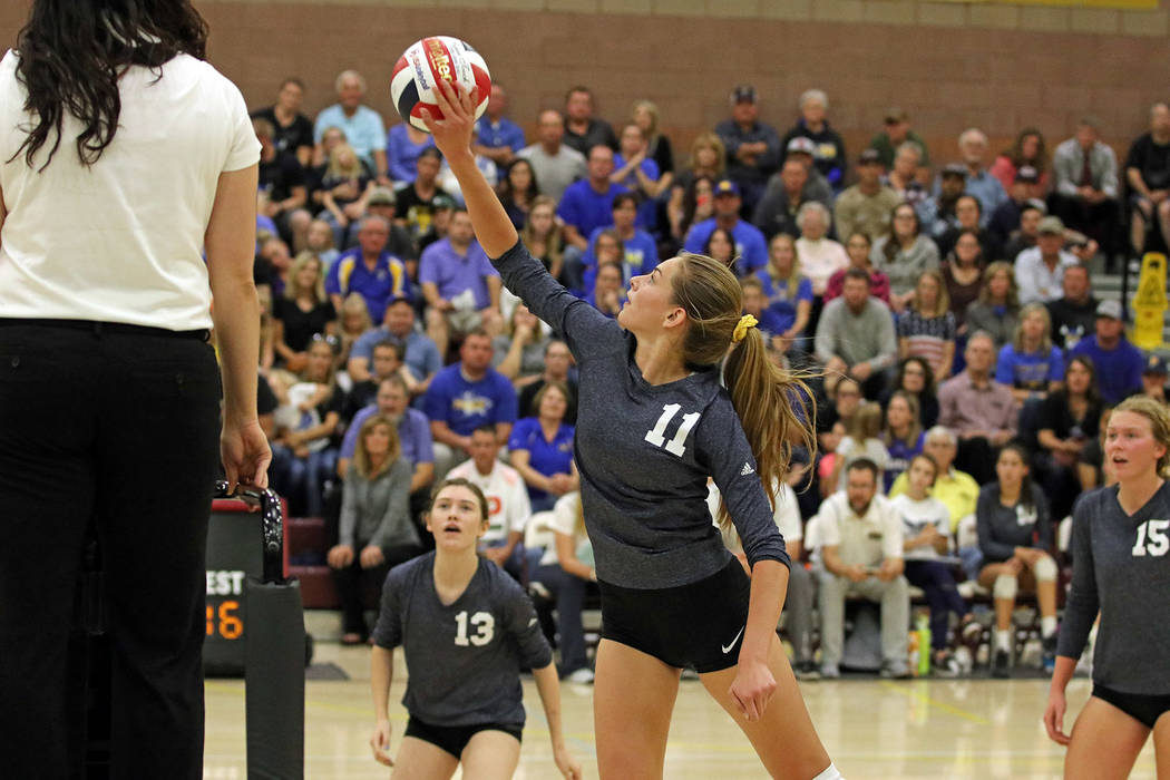 Boulder City High School yearbook Boulder City High School freshman Kamry Bailey, center, tips the ball back over the net as sophomore Raegan Herr, left, and senior Maggie Roe look on during the L ...