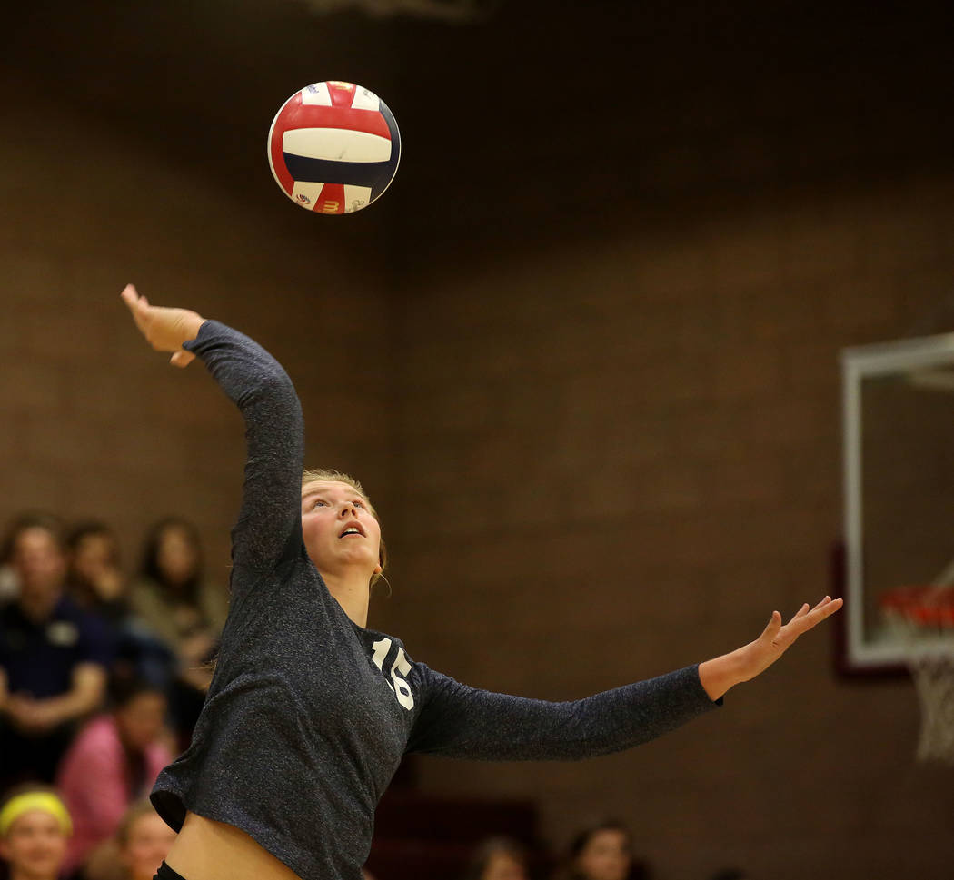 Bridget Bennett/Las Vegas Review-Journal Boulder City player Maggie Roe serves the ball during the class 3A state volleyball championship game against Moapa Valley at Faith Lutheran in Las Vegas o ...