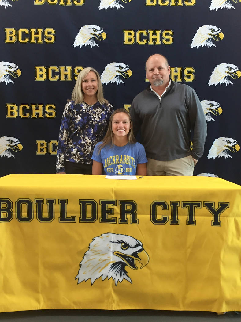 Amy Wagner Boulder City High School golf star Lani Potter is joined by her parents, Jill and father Richard Potter, as she signed her national letter of intent Nov. 8 to attend Division I program  ...