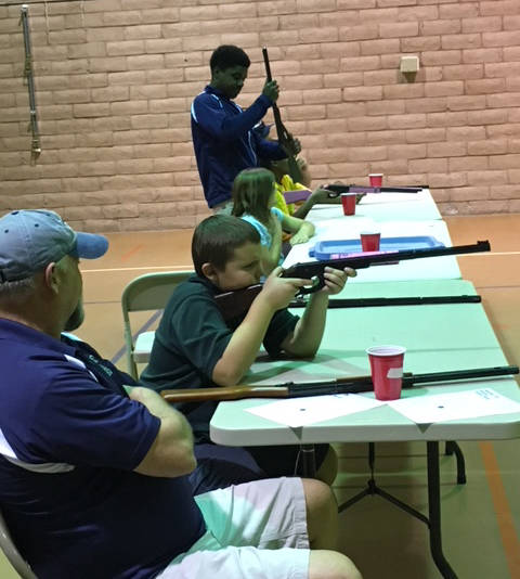 Kelly Lehr Anthony Armstrong, seated in front, takes aim as he competes in the Boulder City Parks and Recreation Department's annual Turkey Shoot held Nov. 14 and 15. He came in first place in the ...