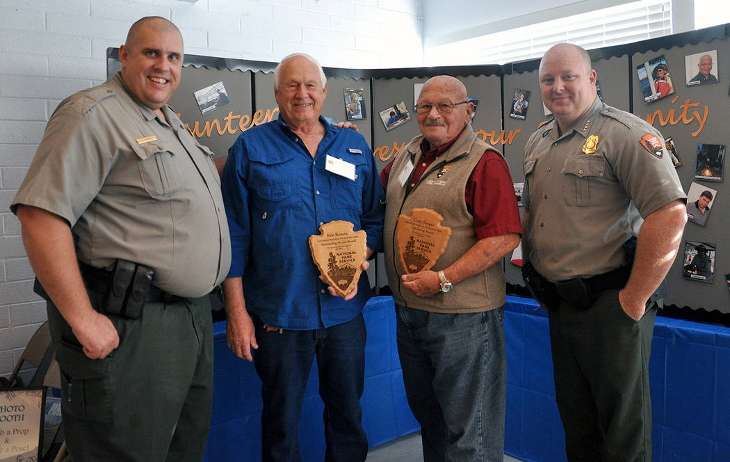 National Park Service Chris Largent, far left, Lake Mead National Recreation Area water activities specialist, and Adam Kelsey, far right, chief ranger, present the Outstanding Service Award to Ke ...