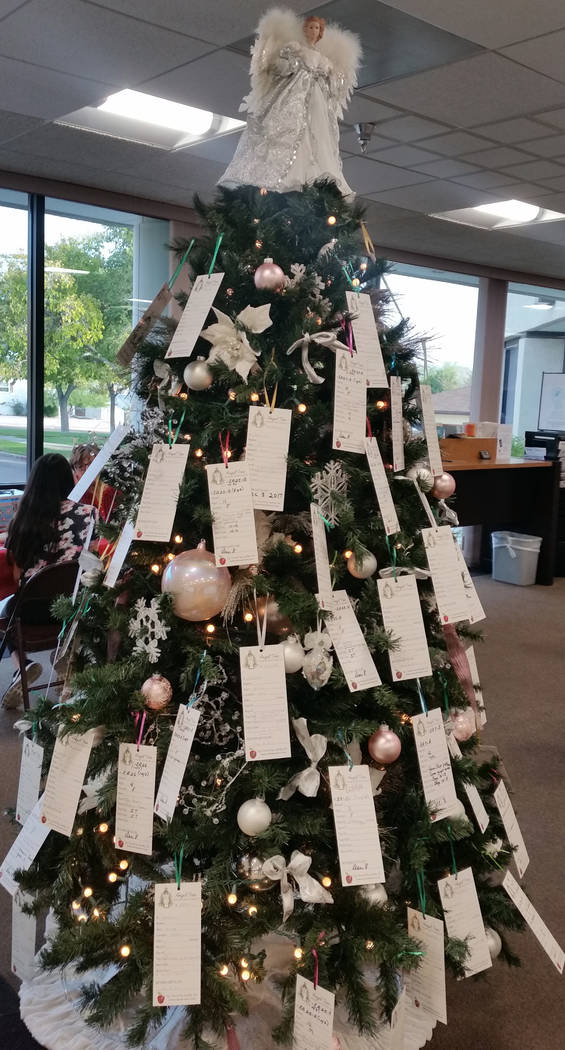 Celia Shortt Goodyear/Boulder City Review Emergency Aid of Boulder City is holding its yearly Angel Tree event with cards to help those in need on the Christmas tree at Boulder Dam Credit Union, 5 ...