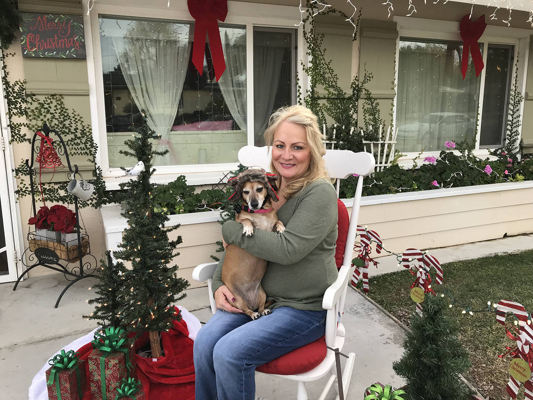 Hali Bernstein Saylor/Boulder City Review Grandma Land, also know as the home of Leah Carter, who is holding her dog Pickle, will be featured on the 42nd annual Home Tour presented by the American ...