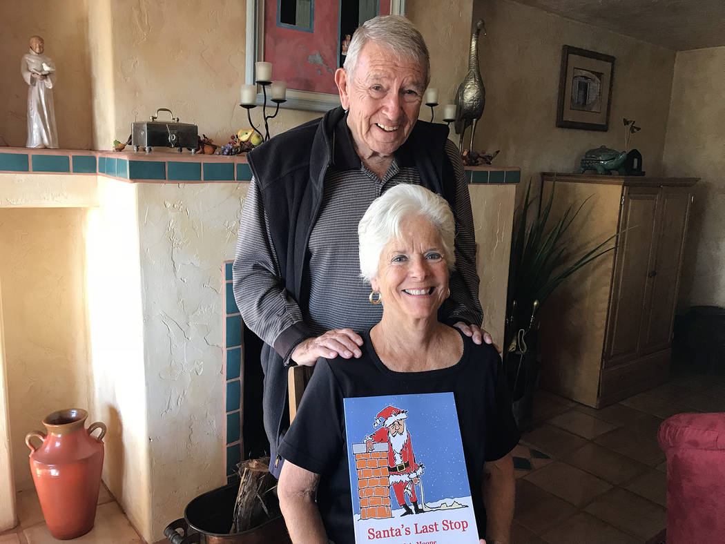 "Hali Bernstein Saylor/Boulder City Review Boulder City resident Merrianne Metzger, known as M.A. Moone, wrote a new children's book for Christmas, ""Santa's Last Stop,"" which was  ..."