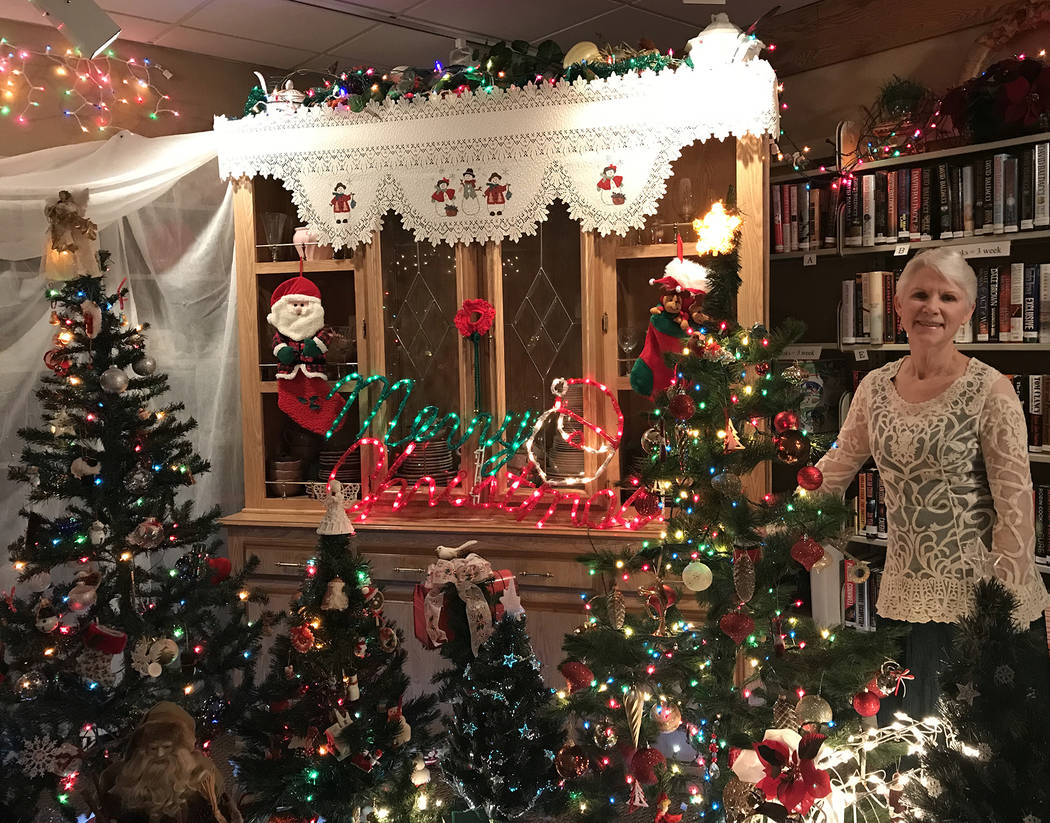 Hali Bernstein Saylor/Boulder City Review Robin Reese volunteers as the manager of the gift shop at the Senior Center of Boulder City. For Christmas, she has transformed the store into a light-fil ...