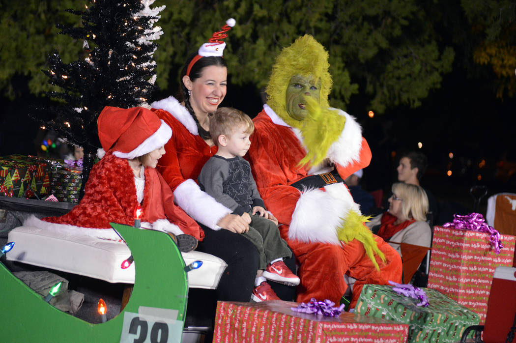 Celia Shortt Goodyear/Boulder City Review  Tom Devlin's Monster Museum found the Grinch at Santa's Electric Night Parade on Saturday. Representing the museum were, from left, Lily Devlin, Lola ...
