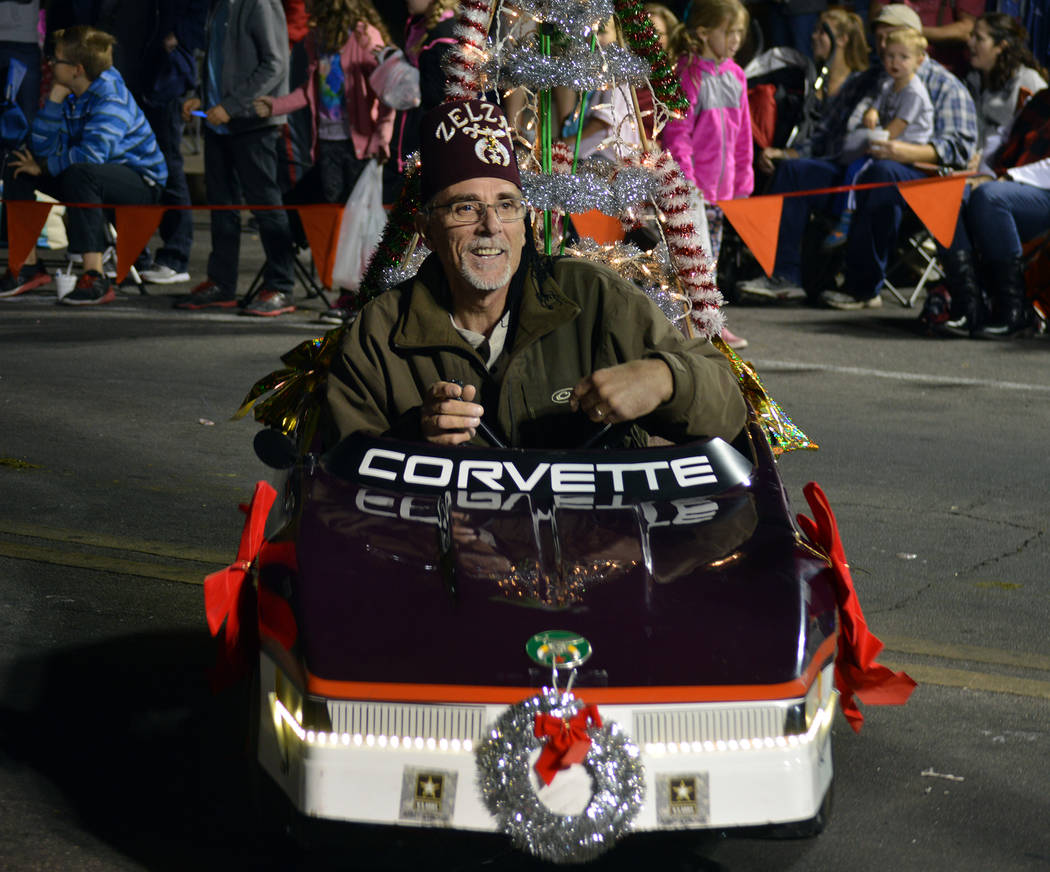 Celia Shortt Goodyear/Boulder City Review Zelzah Shriner and Boulder City resident Jim Giannosa zooms to the crowd in Santa's Electric Night Parade on Saturday, Dec. 2.