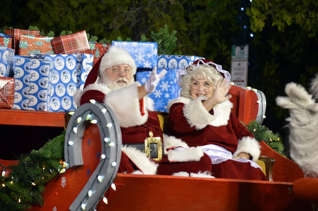 Celia Shortt Goodyear/Boulder City Review Santa and Mrs. Claus greet the crowd at Santa's Electric Night Parade on Saturday, Dec. 2.