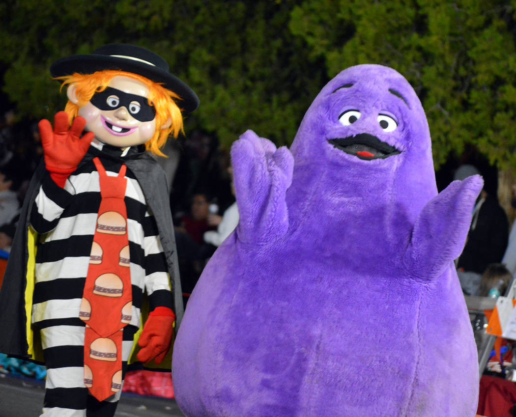 Celia Shortt Goodyear/Boulder City Review McDonald's characters Hamburglar and Grimace wave to the crowd at Santa's Electric Night Parade on Saturday, Dec. 2, in Boulder City.
