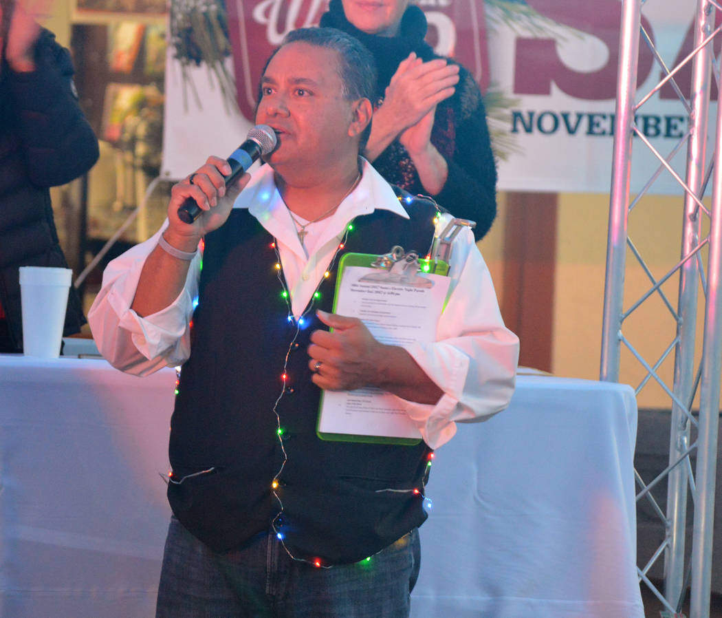 Celia Shortt Goodyear/Boulder City Review Mike Pacini announces the parade entries on Saturday, Dec. 2, during Santa's Electric Night Parade.
