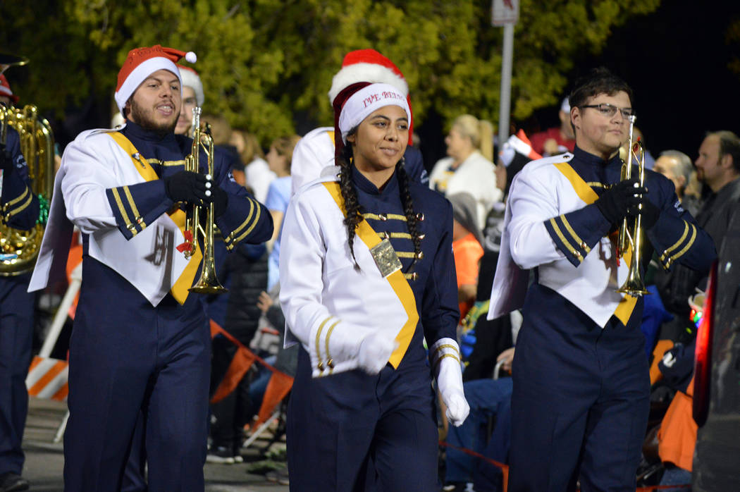 Celia Shortt Goodyear/Boulder City Review Boulder City High School Marching Band members, from left, Jesse Matuska, Gwynneth Miller and Weston Martin march in Santa's Electric Night Parade on Satu ...