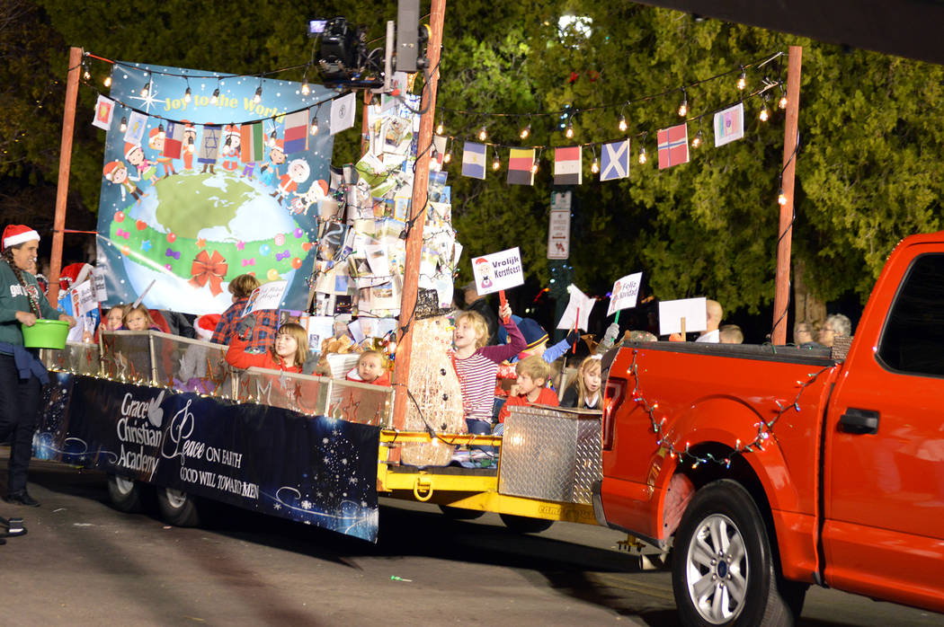 Celia Shortt Goodyear/Boulder City Review Grace Christian Academy showcases a Christmas around the world float for Santa's Electric Night Parade on Saturday, Dec. 2.