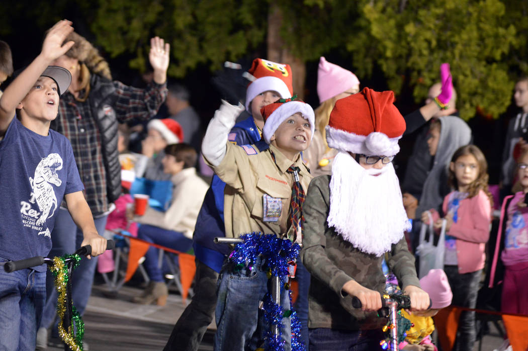 Celia Shortt Goodyear/Boulder City Review Members of the Boy Scouts of America wave for the camera during Santa's Electric Night Parade in Boulder City on Saturday, Dec. 2.