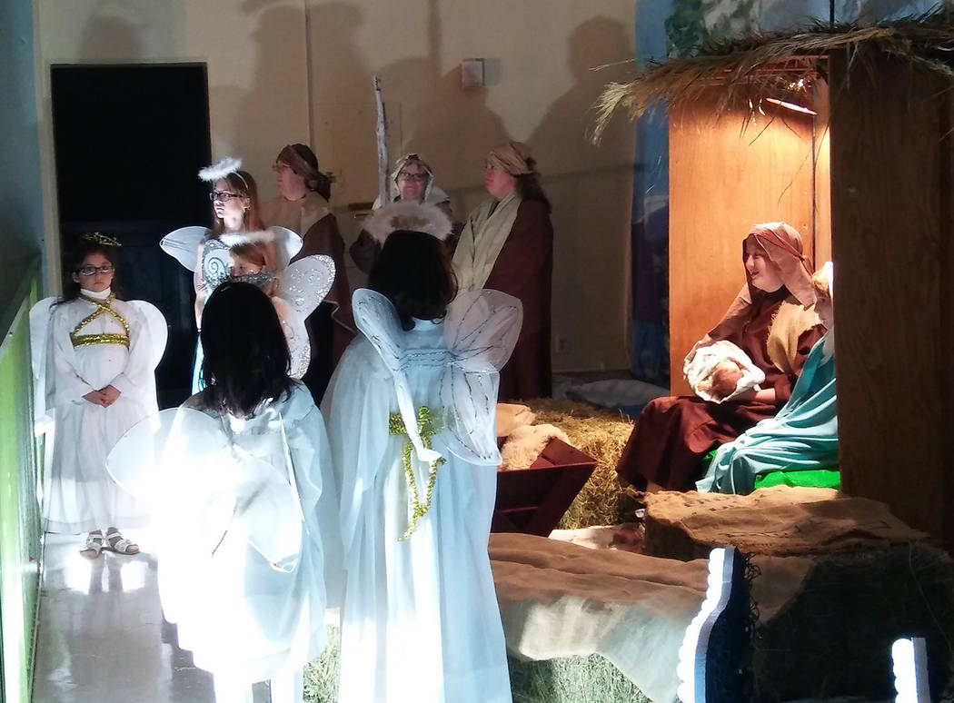 Valerie Olsen/Boulder City Review Joseph and Mary, portrayed by Cameron Johnson and Elise Vanier, are surrounded by angels and wise men during the Las Posadas presentation on Nov. 30 in the gym at ...