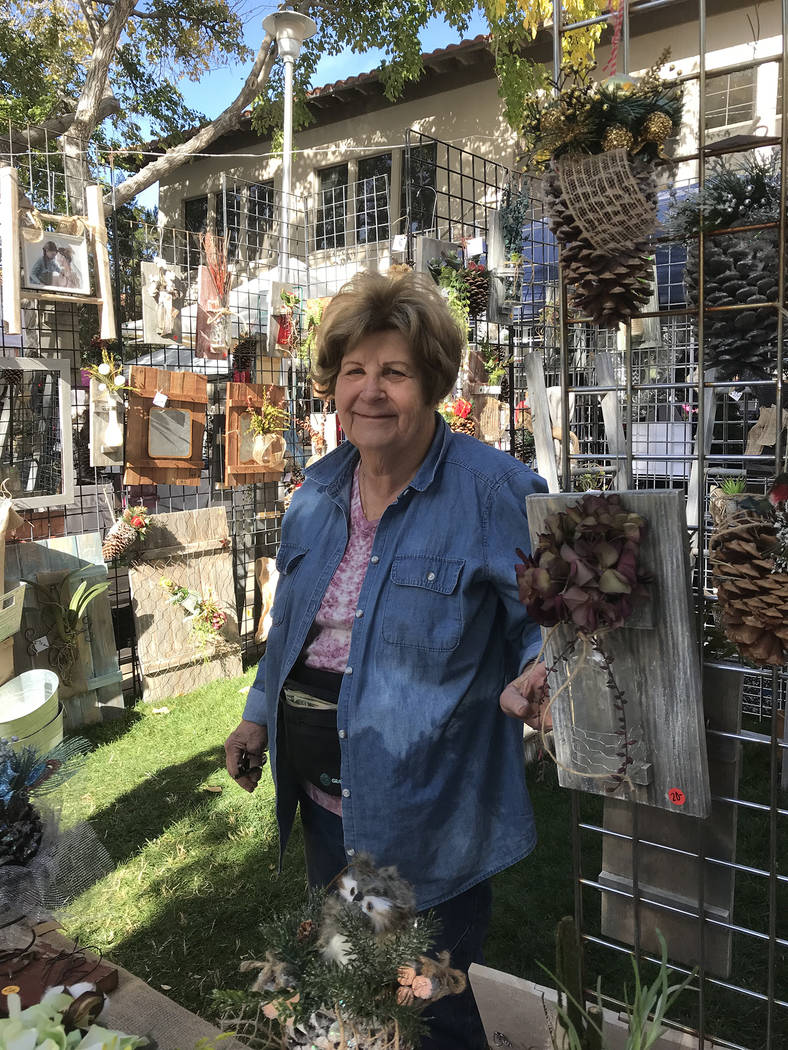 Hali Bernstein Saylor/Boulder City Review Longtime vendor Marge Etheridge of Henderson returned to the Doodlebug Bazaar on Saturday after a five-year absence. She was selling holiday items and wal ...