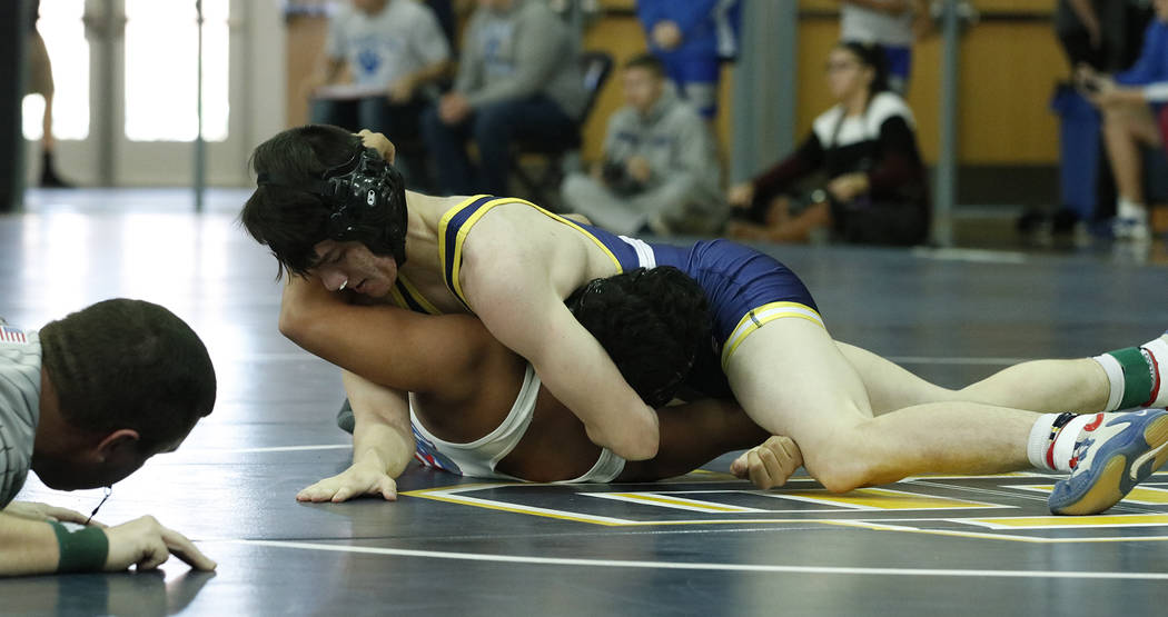 Tristin Phelps/Boulder City Review Boulder City High School senior Zayne Dennington uses his strength and technique to pin his opponent. He was one of eight Eagles who went undefeated during the B ...