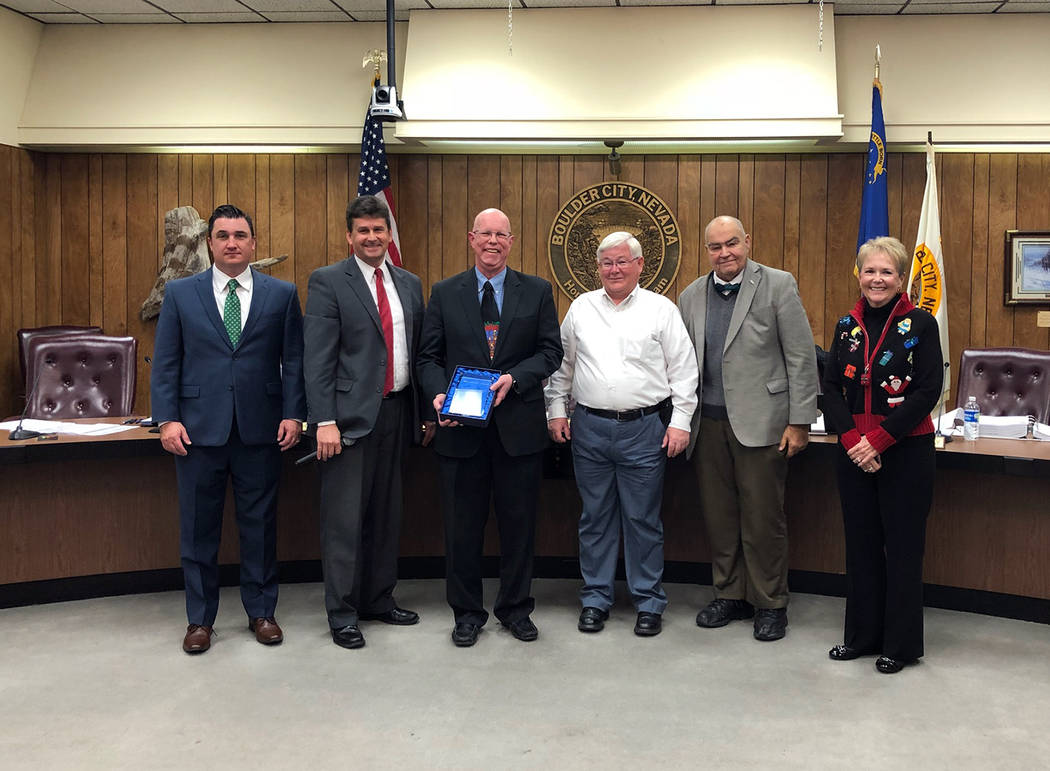 Boulder City City Council awarded Judge Victor Miller the 18th annual Bill Andrews Award for outstanding community service to the city during its meeting Tuesday. Making the presentation were, fro ...