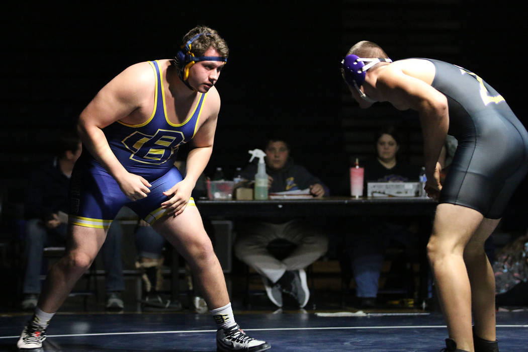 Bryce Rogers/Boulder City Review Junior Mike Kaposta, left, earned victories in the Eagle's matches against Durango and Chaparral on Dec. 6, and finished in 10th place for Boulder City High School ...