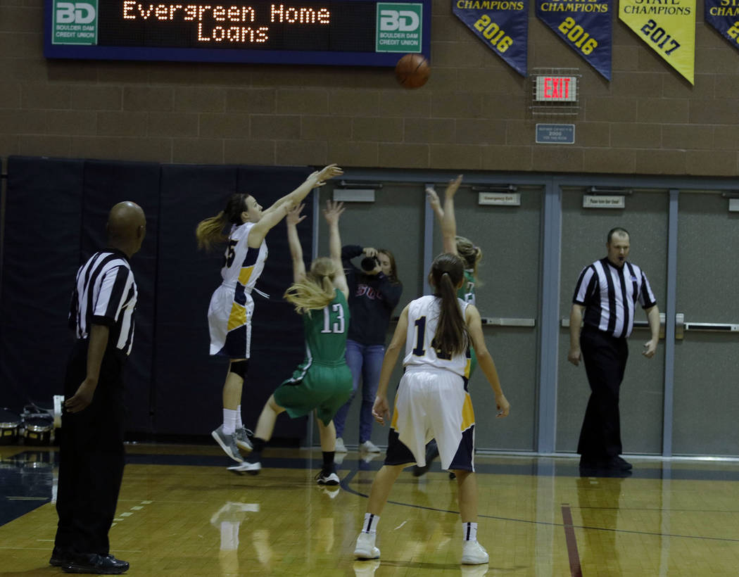 Tristin Phelps/Boulder City Review Boulder City High School junior Hannah Estes shoots a 3-pointer as the Lady Eagles were down by 4 points in hopes to take the lead during their Dec. 14 game agai ...