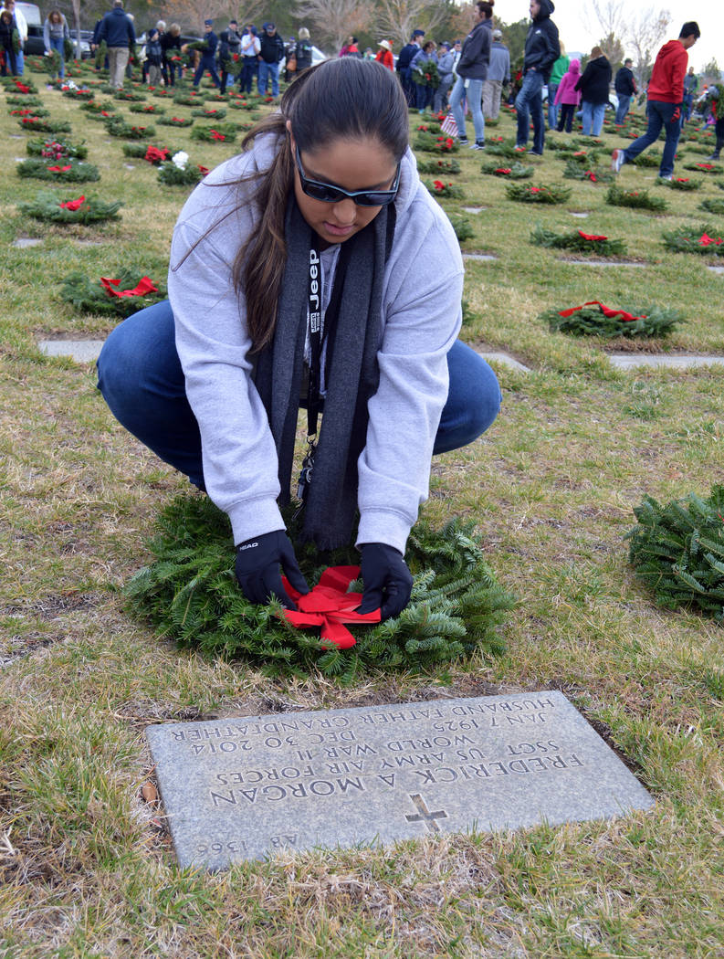 Celia Shortt Goodyear/Boulder City Review Amanda Cotalano straightens a wreath at the grave of World War II veteran Frederick Morgan as part of Wreaths Across America on Saturday.