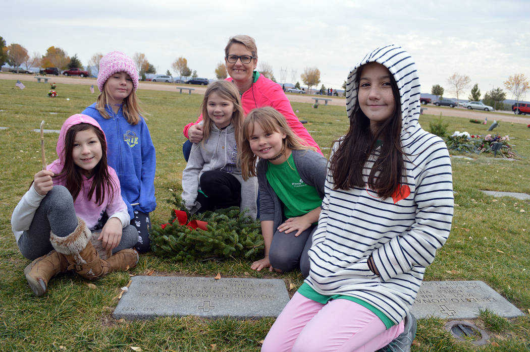 Celia Shortt Goodyear/Boulder City Review Tammy Biancolin, in back, lays a wreath on the grave of her best friend's father, Howard Thomas McKee, along with, from left, Kallie Sears, Eleonora Bianc ...