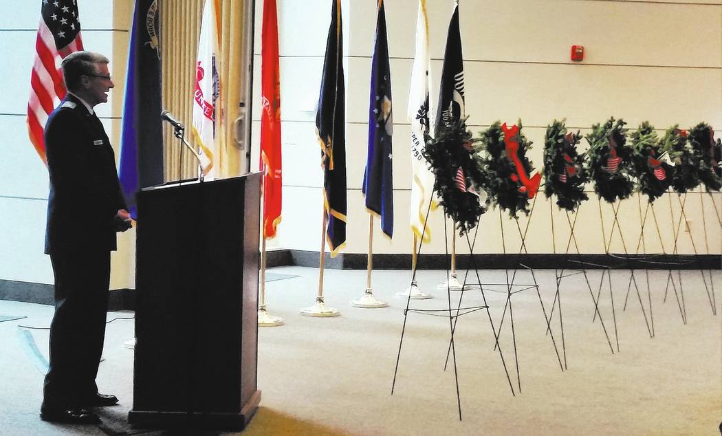 Celia Shortt Goodyear/Boulder City Review Civil Air Patrol Maj. James Grindstaff leads the placement of the ceremonial wreaths in the chapel at the Southern Nevada Veterans Memorial Cemetery for t ...